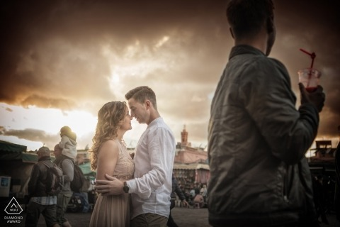 Venice engagement photography | Veneto couple poses in a crowded area below dramatic clouds