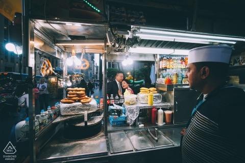 NYC Street food vendor participates in this pretzel engagement portrait