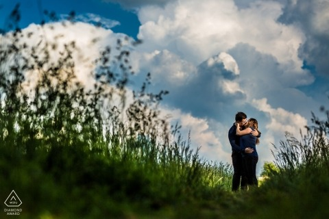 Czech Republic outdoor engagement photos - pre-wedding session in the tallgrass Blue skies and white puffy clouds