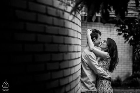 This Czech Republic couple found the perfect curved brick wall for their black and white pre-wedding portrait
