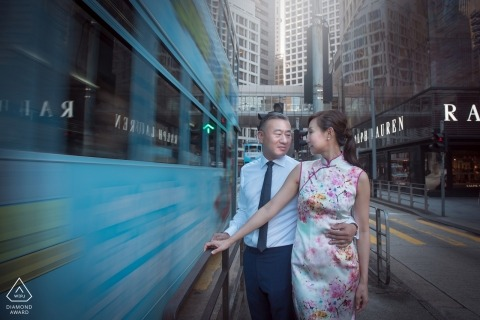 Hong Kong couple Pose as a train car whizzes passed during their engagement portrait
