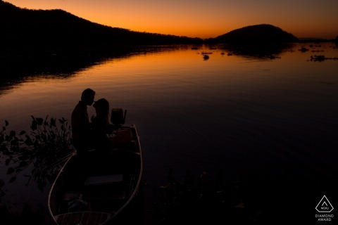 Rio de Janeiro mountains and waterways draw this couple to the boat for this sunset engagement portrait