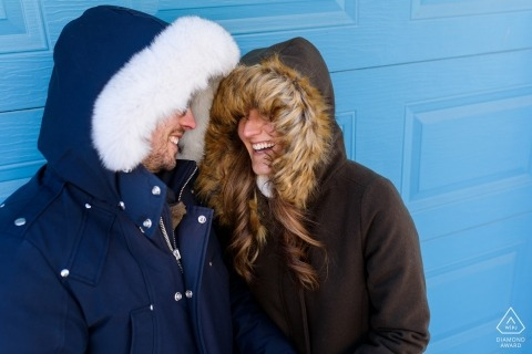 A very cold Montréal Québec engagement portrait session with heavy winter jackets and hoods