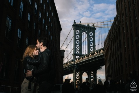 New York City late afternoon engagement portrait against the Brooklyn Bridge