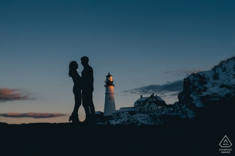 Boston lighthouse pre-wedding engagement portraits - silhouette against the blue sky