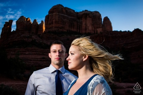 Arizona pre-wedding engagement portrait with the steep cliffs and blowing wind