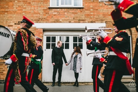 East Midlands UK couple framed portrait between rows of musicians in a marching band by a Northamptonshire wedding photographer