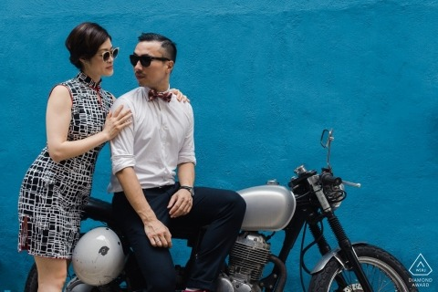 A vintage motorcycle provided this San Francisco couple the look they were after for their pre-wedding portrait