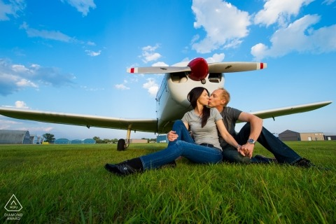 An aviation couple from Minnesota have an engagement portrait created with their airplane