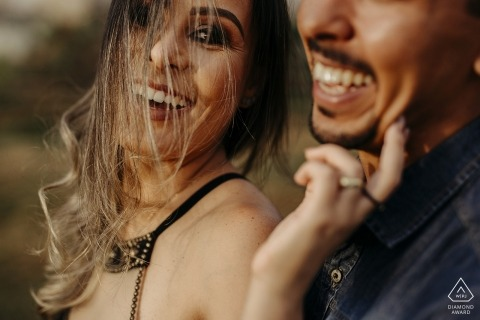 windy Engagement Portraits with tenderness in Minas Gerais Brazil