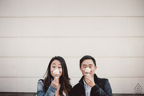 This New York City couple is having fun with their two ice cream cones during their portrait session