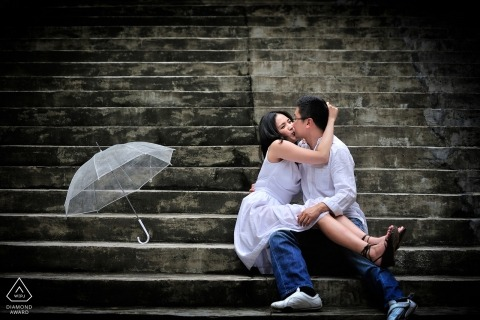 Prewedding photo session on stairs with umbrella by Hong Kong photographer