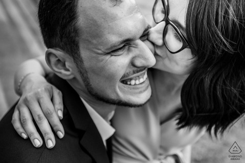 Bucharest couple tightly framed in a black-and-white portrait with a kiss on the cheek