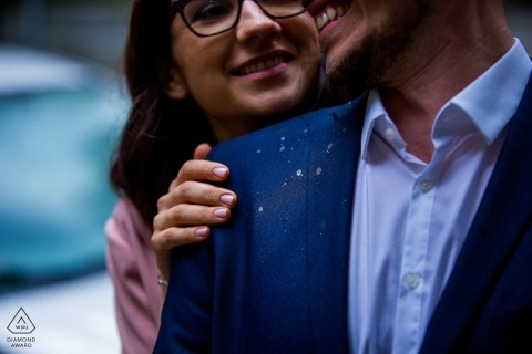 A very tightly cropped image of an engaged couple posing for their pre-wedding portrait