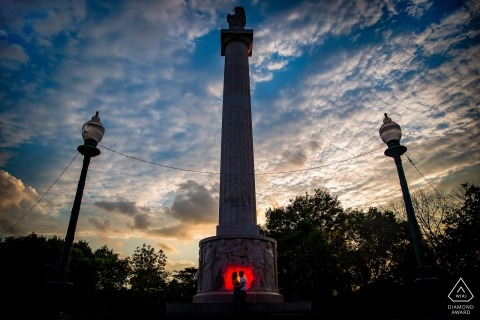Chicago engagement portrait lit with a red light at a central monument