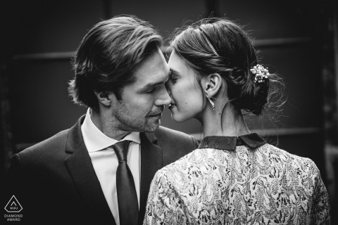 Almost a kiss, this symmetrical portrait shows the love between this newly engaged couple