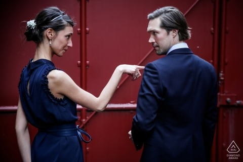 Industrial steel painted red create a bold backdrop for this recently engaged fun loving couple