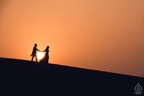 Maharashtra engagement portrait at sunset walking hand in hand on the Hill