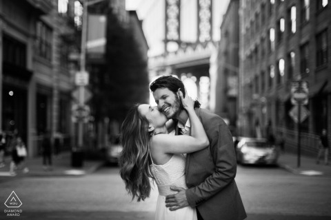 New York City black-and-white engagement portrait session on the streets with a kiss