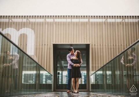 Singapore pre-wedding portrait session with symmetry, corrugated metal and glass railing