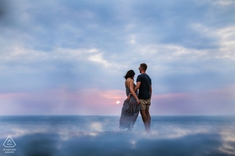 Waves water clouds and mist in this Sri Lanka engagement portrait