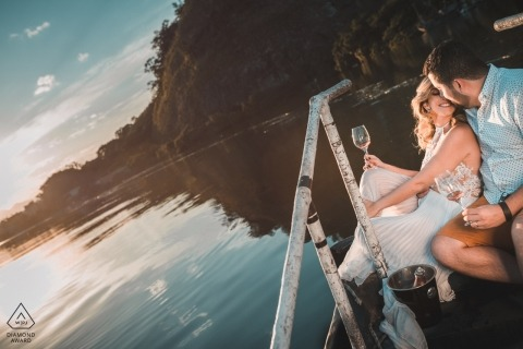 Glasses for wine and a water side perch worked well for this Rio de Janeiro couple and their engagement portraits