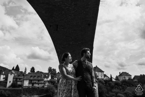 french couple | engagement photography under a bridge