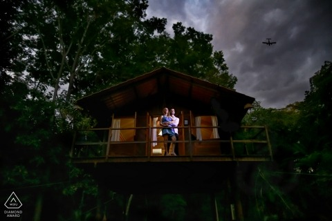 Perched in a tree house this Brazil engaged couple poses for a pre-wedding portrait