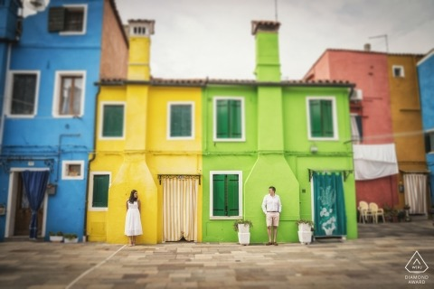 A rainbow of colors provide a vibrant backdrop for this Venice couples engagement portrait