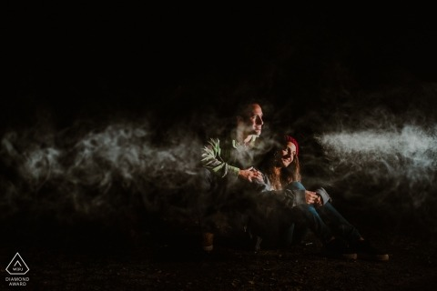 Biscay engagement portrait session with selective lighting and fog
