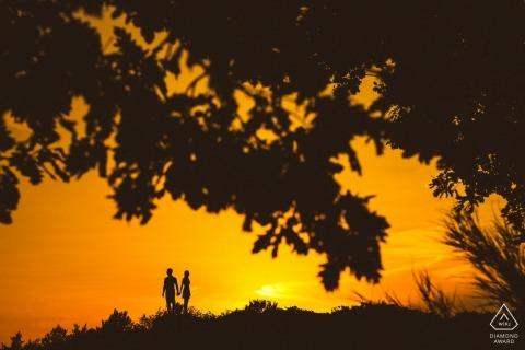 silhouette, sunset, framed engagement shoot | Stronger together