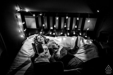 București Couple Reading in Bedroom - Engagement Photographer for Romania