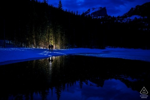 Rocky Mountain National Park Engagement in Colorado at Dusk with a Light