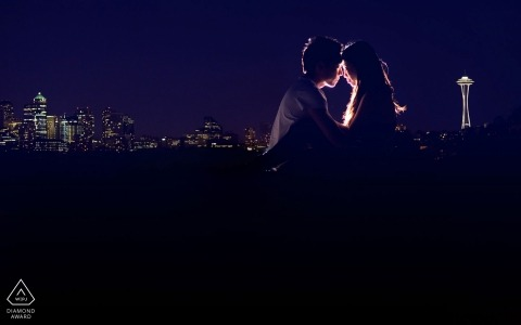 A backlit Washington portrait for this engaged couple with the city skyline of Seattle behind