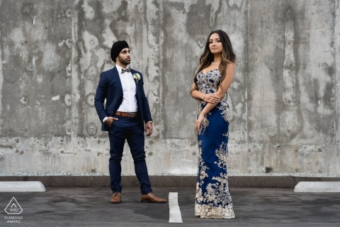 San Diego engaged couple during their pre-wedding portrait photoshoot at concrete parking structure
