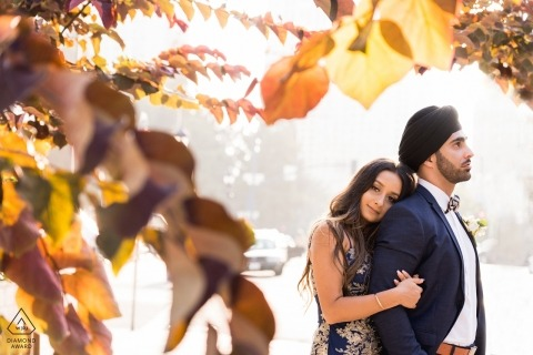 California Engagement Photograph of a couple with fall leaves