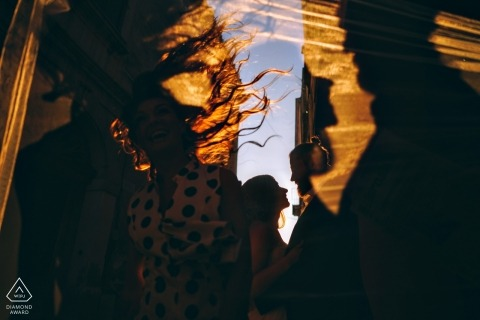 NYC engagement portrait shot in silhouette style with wind blowing her hair to resemble flames