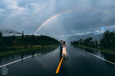 Rain covered highway with Rainbow - Alberta Engagement Photo Session with a couple