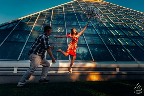 Alberta Engagement Portrait of a couple in the sun with a glass building