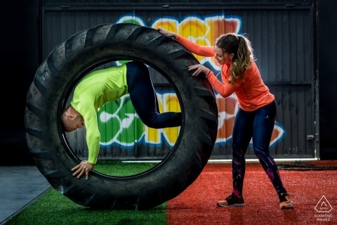 Valencia engagement portrait session with a couple working out at the gym with the tractor tire