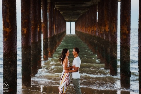Engaged couple beneath Southwold Pier, UK | Wedding Photography