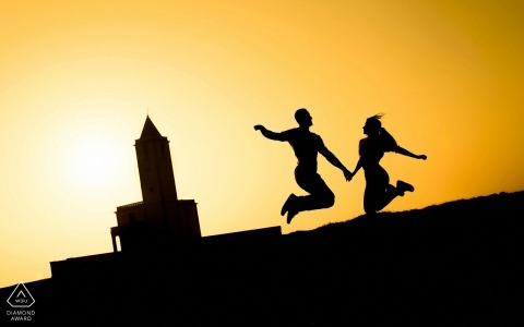 Murcia Engagement Photograph of Couple Jumping at Sunset