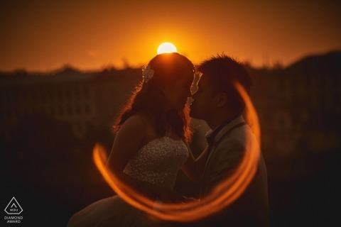 Prague Czech Republic Sunset Flare Engagement Photograph of Couple