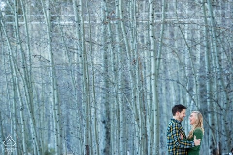 lake tahoe pre wedding photos of a couple against tall, white birch trees