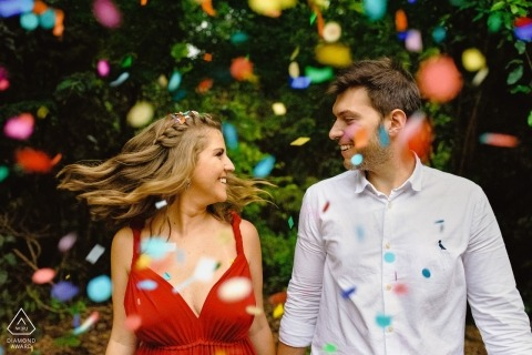 Rainbow confetti flies during a pre-wedding portrait session in Brazil