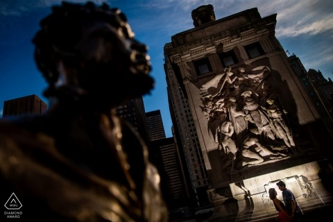 IL wedding engagement portrait of a couple near dusk with statues   Chicago pre-wedding photographer session