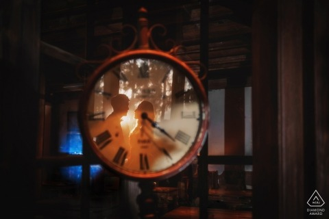 Fujian pre-wedding engagement pictures of a couple reflected in a clock face | couple photography session