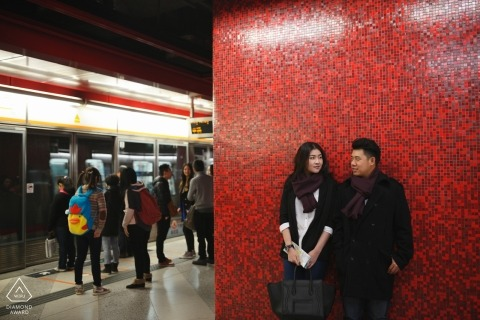 Lovers in Hong Kong Metro station pose for engagement portrait