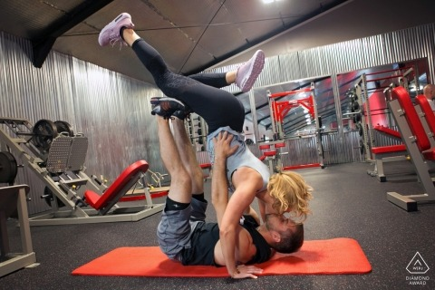 engagement photo session | female and male, at fitness center