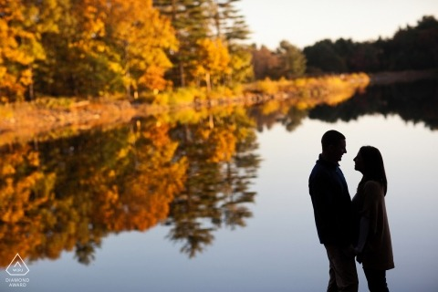 Couple along a lake during a fall engagement portrait session in Rhode Island